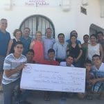 Donors and students with fund Raiser check